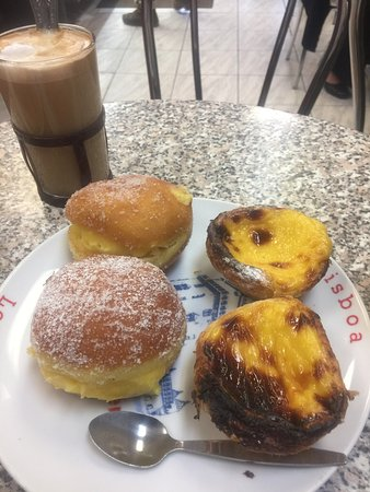 Photo of Cafe Lisboa Patisserie at 57 Golborne Road, London W10 5NR, United Kingdom