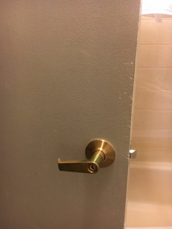 Waukesha, Wisconsin: Caked on layers of paint on bathroom door with flakes missing.