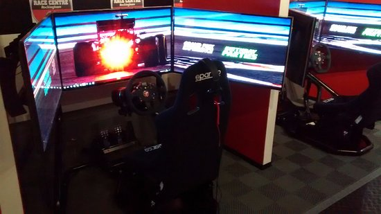 Corby, UK: Three massive TV screens immerse you in the driving sim :-)