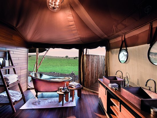 One Nature Nyaruswiga Serengeti: Luxury Family Tent en-suite bathroom with freestanding copper bathtub and glass enclosed shower
