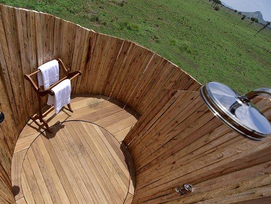 One Nature Nyaruswiga Serengeti: Outdoor shower with rainfall showerhead and hansgrohe fixtures