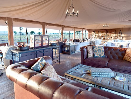 One Nature Nyaruswiga Serengeti: Main Lounge with seven different clusters of luxurious indoor lounge sets and outdoor sitting ar