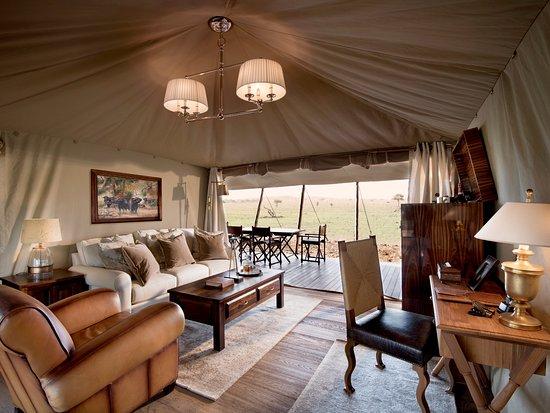 One Nature Nyaruswiga Serengeti Luxury Family tent sitting area with private veranda overlooking the Nyaruswiga & Luxury Family tent sitting area with private veranda overlooking ...