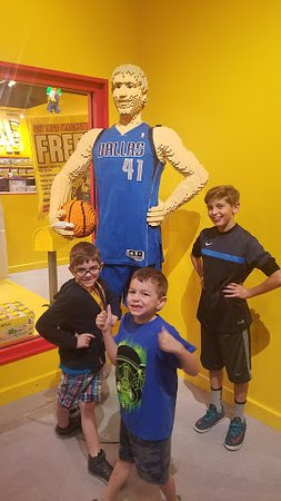 Legoland Discovery Center: my kids posing in front of dirk nowitzki Lego figure!