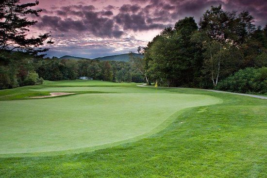 Killington, VT: Hole #3 under a purple setting sky...