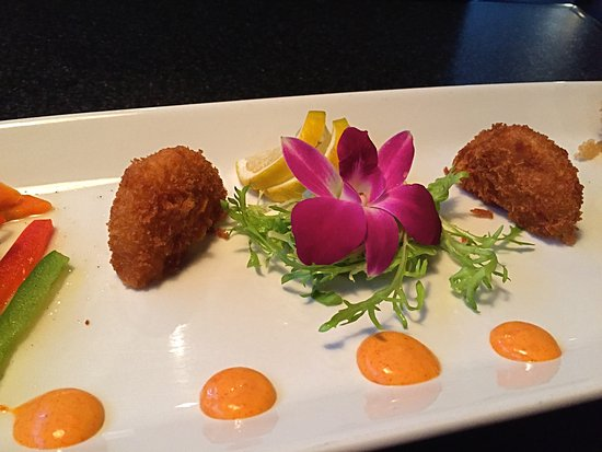 "Ferndale, MI: Edible flower and ""hush-puppies"" on Emperor's filet plate"
