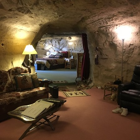 Kokopelli Cave Bed and Breakfast : view from den to master bedroom, curtain for privacy