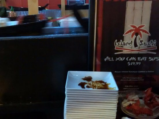 Kimberly, WI: sushi boats, menu, and a stack of empty sushi trays at Island Sushi