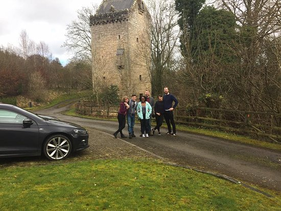 Braidwood, UK: all of us outside the tower after a superb stay.