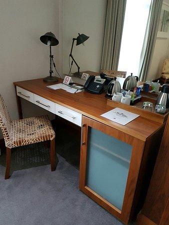 The Square Boutique Hotel & Spa: Desk, fridge and riempie type chair