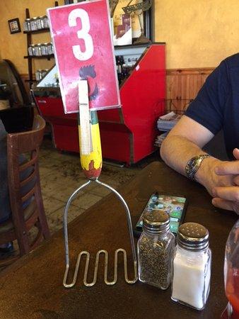 Cottonwood, AZ: Potato masher table card! Quaint! 🐔