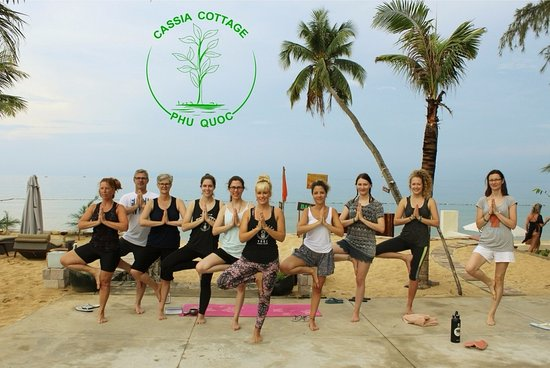 Yoga session at Cassia Cottage's beach front