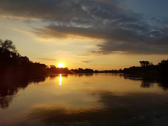 Chirundu, Zambia: Sunset on the Kafue River, returning from a boat cruise.