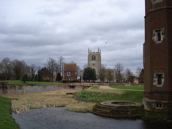 Tattershall, UK: Castle moat, guard house, and Collegiate Church.