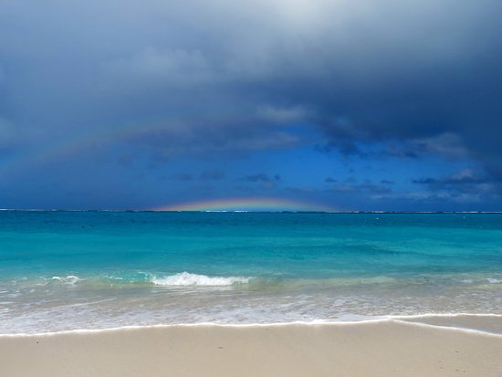 Harbour Club Villas & Marina: Grace Bay beach is five minutes drive away....rainbows and a passing ocean storm