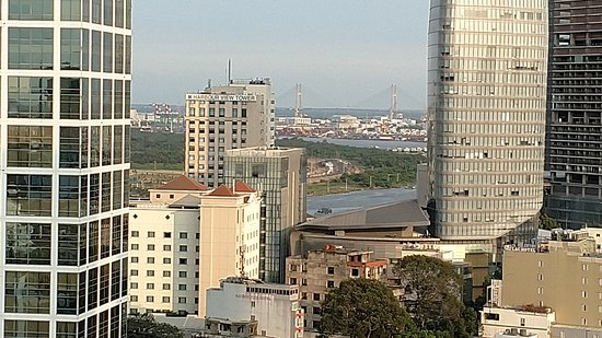 Liberty Central Saigon Citypoint Hotel: View towards the river from rooftop pool.