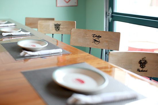 Stratford, CT: Take a seat at the bar - our stools feature vintage automotive logos!