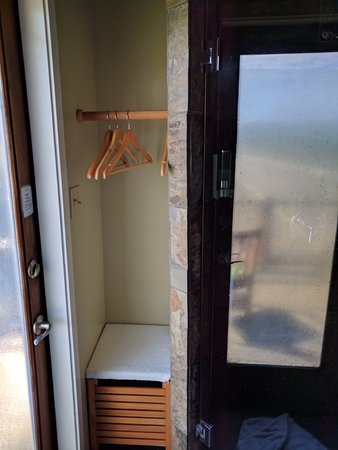 Inverness, CA: Hanger, basket for dirty clothes, door to the private patio on the left & door to shower on righ