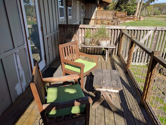 Inverness, CA: Private porch of room #5 with nice furniture. View is of the bay.