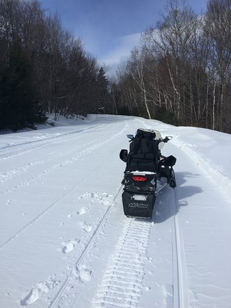 Northern Extremes Snowmobiling - Tours: Double Sled on trail!