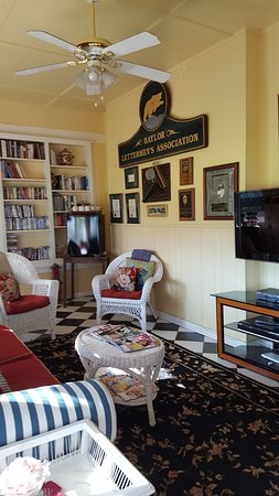 The Cotton Palace: Sun room with DVD's and a Kurig coffee maker