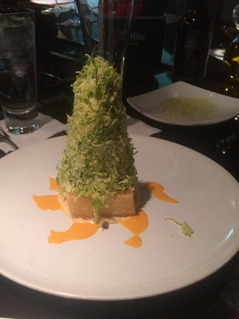 Southington, CT: Parmasean shaved Brussels sprouts over a bed of fried risotto
