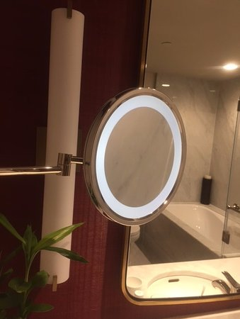 The Parisian Macao A Lighted Vanity Mirror With An Extendable Arm
