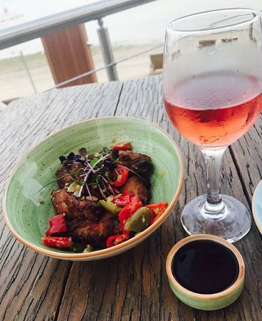 Chicken Wings And Rose Wine At Breeze Beach Grill Picture Of