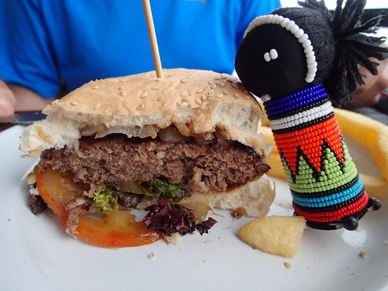 Storms River, South Africa: Appines (doll) loving her burger