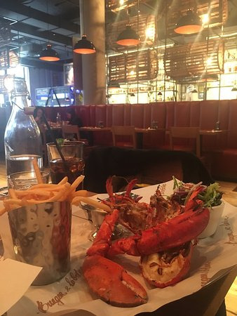 Photo of American Restaurant Burger & Lobster at 39 W 19th St, New York City, NY 10011, United States