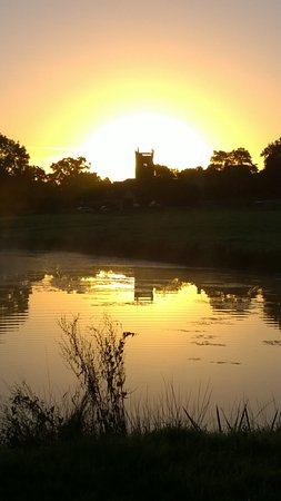 Temple Cloud, UK: Sunrise over Cameley Lakes and St James Church