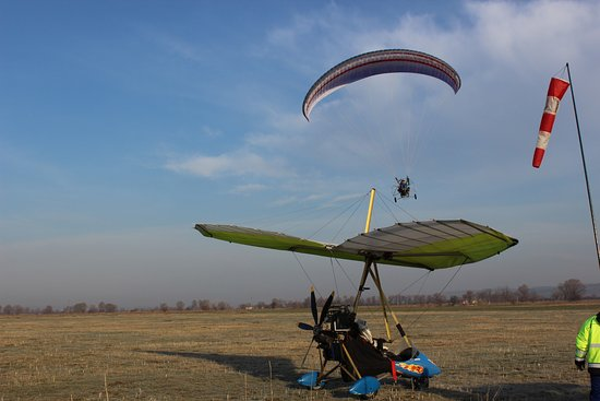 Powered paraglider meets it's cousin powered hang-glider