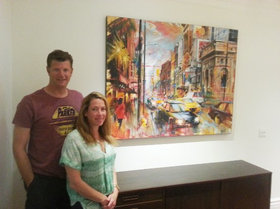 Cambridge, Canada: Happy Toronto customers with their new, original painting of Toronto by Alex Krajewski