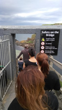 Ballintoy, UK: About to cross the rope bridge.