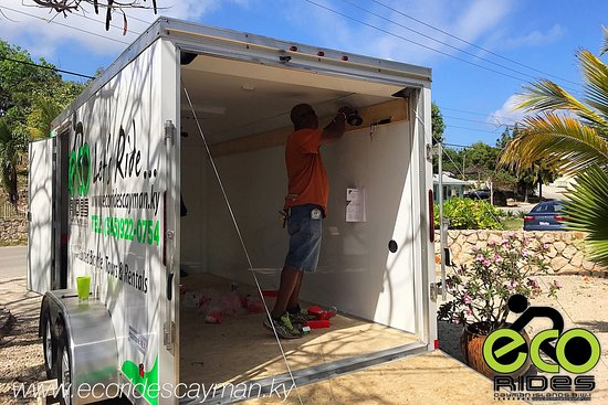 East End, Grand Cayman: ECO Rides Cayman working on our awesome trailer! Thanks to my fellow Eastender for all the help.