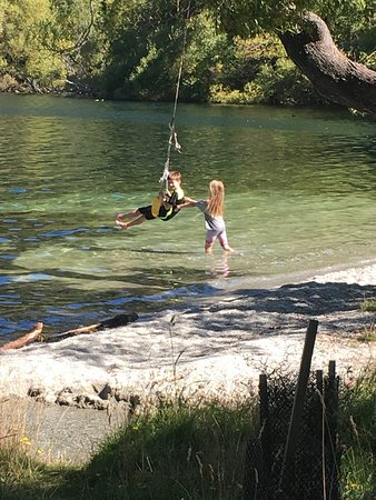 Arrowtown, New Zealand: swinging over the water