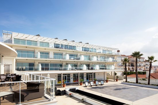 The Beachfront Apartments: Exterior Area with Kids Club, mini market and Restuarant