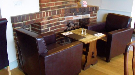 Peacehaven, UK: Chairs by the fire