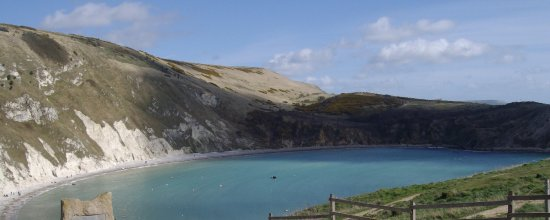West Lulworth, UK: The chalk cliff wall defies the attack from the sea
