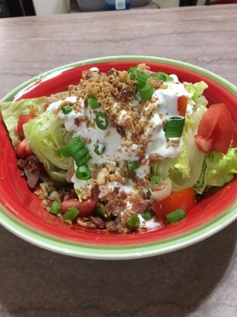 Trinidad, CO: Wedge Salad: Iceberg lettuce, tomatoes, green onions, & bacon bits with home-made creamy ranch.