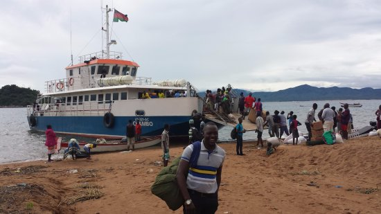 "Likoma Island, Malawi: Trevor with my bag, just about to board the ""Chambo"""
