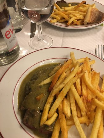 Photo of French Restaurant Relais de l'Entrecote at 15 Rue Marbeuf, Paris 75008, France