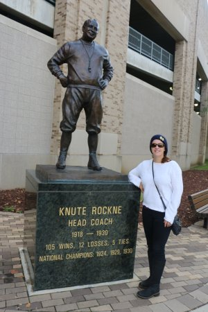 University of Notre Dame: Daughter with Knute Rockne statue by the Rockne north gate.