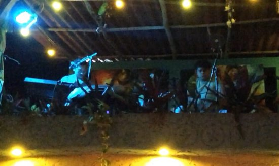 Conato 1910: Band up on roof-performers mix of waiters&booked.Locals loved songs&joined in.Quite loud&needs b