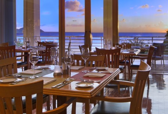 Prego: Enjoy ocean views & Guam's iconic sunsets over Tumon Bay from window seating or balcony dining.