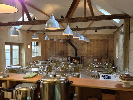 Chippenham, UK: Breakfast in our cosy tearoom with woodturning stove and access to the kitchen garden