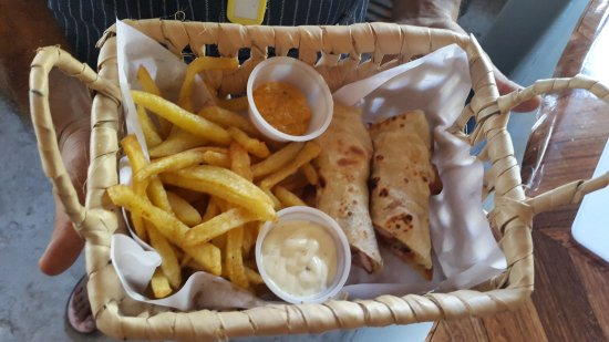 Tofo, Mozambique: Our signature Chicken Tikka cheese Paratha and Masala Garlic Mayo Fries!