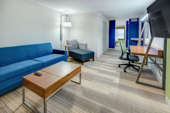 Avenel, NJ: Spread Out in the King Suite with Convertible Coffee Table