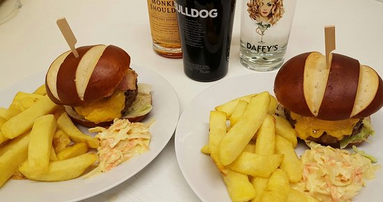 Kinross, UK: A couple of our delicious, home made burgers and a small selection of the spirits we have in hou