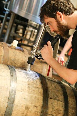Mishawaka, IN: Head brewer, Simon, Czeching out the barrels